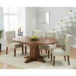 Torino Dark Solid Oak Extending Pedestal Dining Table with Safia Fabric Dark Oak Leg Chairs